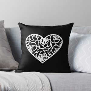 Black throw pillow with heart design